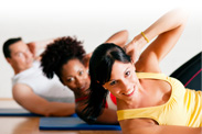 Three people doing oblique crunches